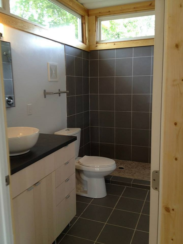 Looks are deceiving at this eco friendly shipping - Shipping container bathroom design ...