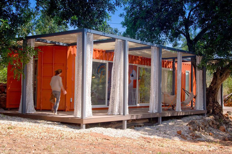 Rusty shipping container transformed into a glamorous for Guest house construction cost
