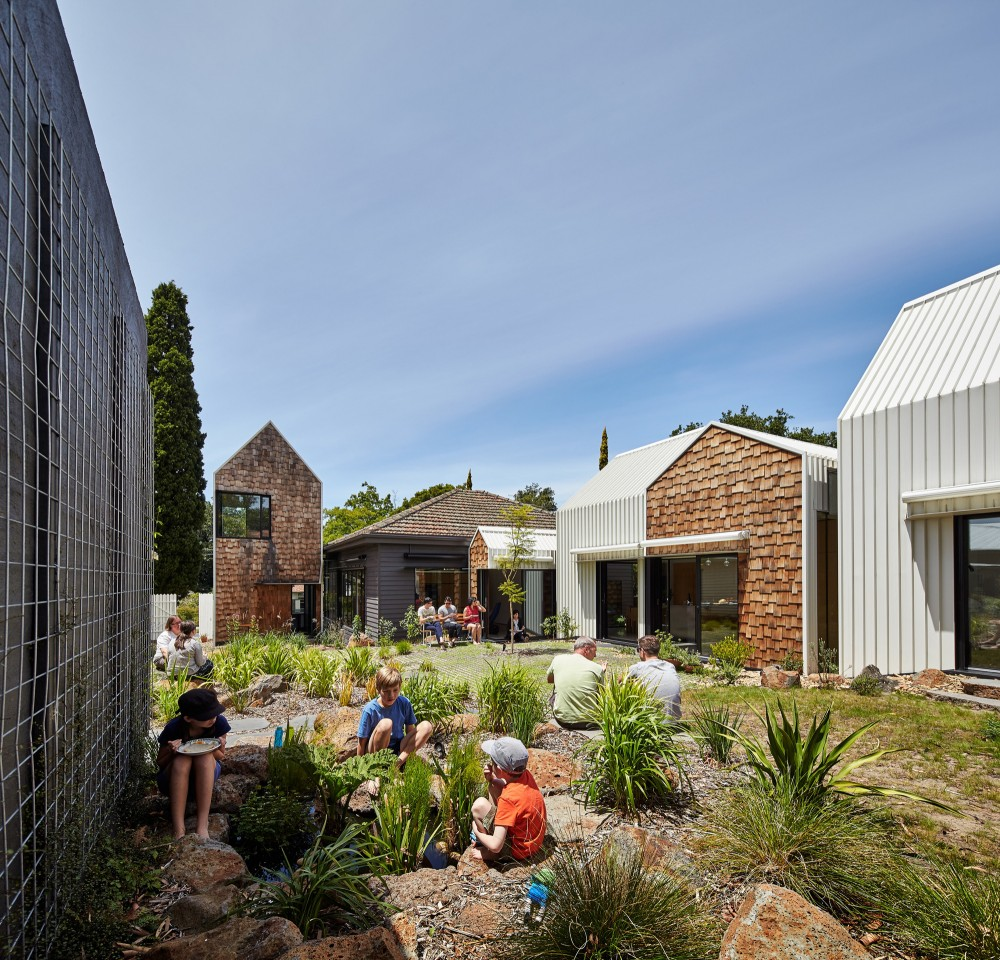 A series of smaller-scale structures create a sense of community at Tower House