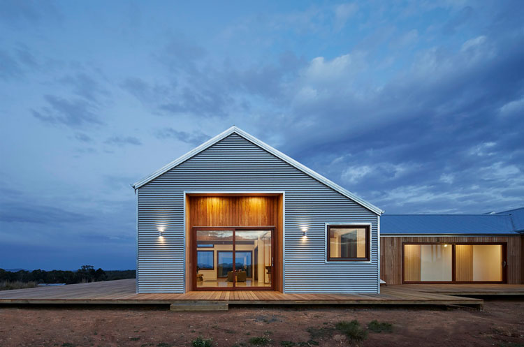 trentham modern farmhouse uses local materials to fit into