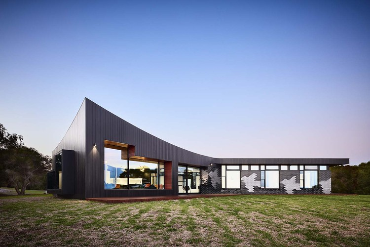 The glazed brick facade at this beach house is inspired by for Beach house builders gippsland