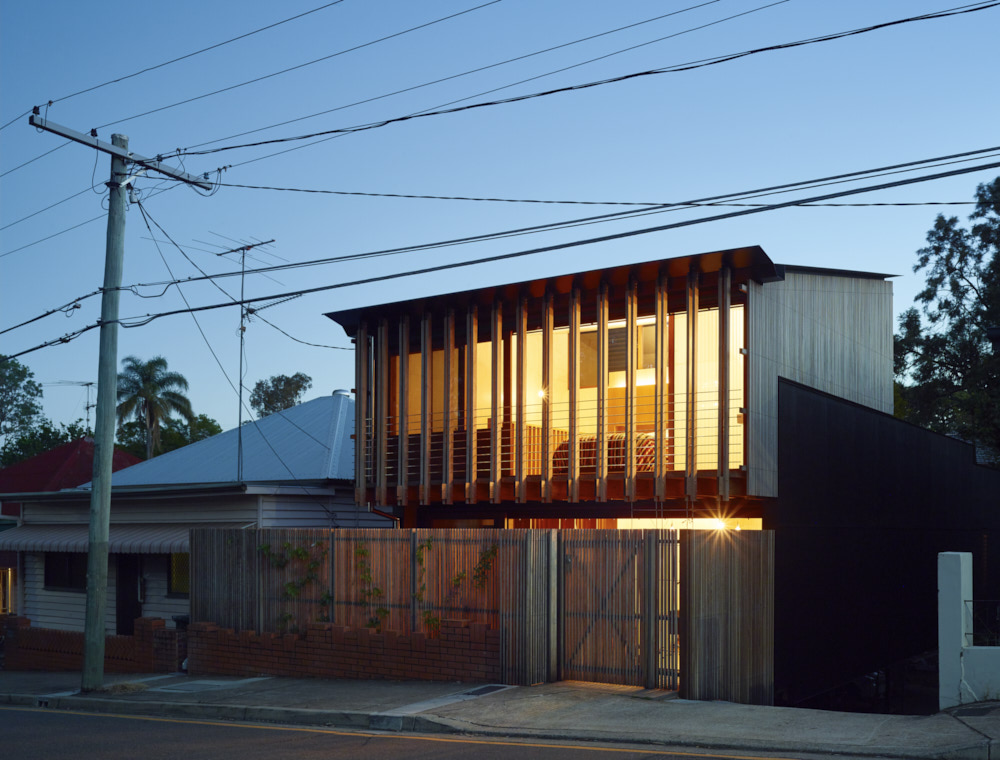 A modern take on a timber workers cottage fits in to for Architecture firms brisbane